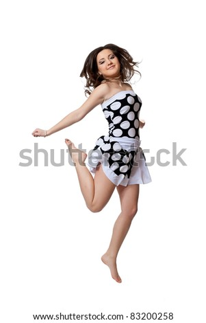 Dancing in black and white dot dress isolated on a white background - stock photo