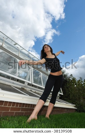 dancing in front of the green house - stock photo