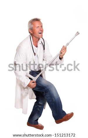dancing mad doctor with crutches on white background - stock photo