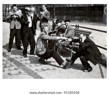 dancing on the train station - photo scan - about 1950 - stock photo
