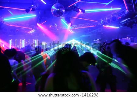 dancing people before flashing laser beams - stock photo
