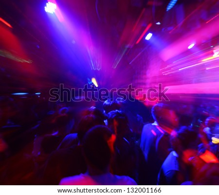 Dancing people in a disco, cheery party. - stock photo