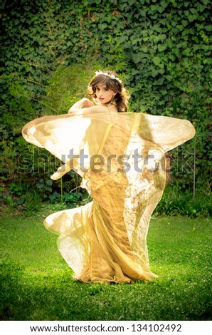 Dancing princess in the park - stock photo