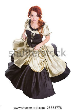 dancing rust-coloured woman in old-fashioned dress - stock photo