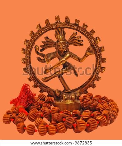 Dancing Shiva with joga necklace mala, isoladed on orange - stock photo
