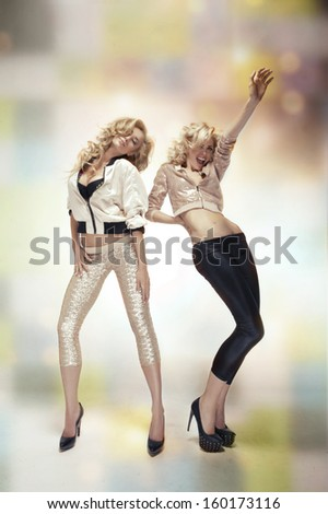 dancing two sexy women - stock photo