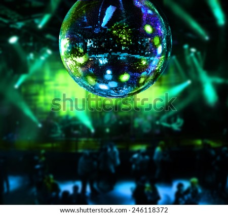 Dancing under disco mirror ball night club background - stock photo