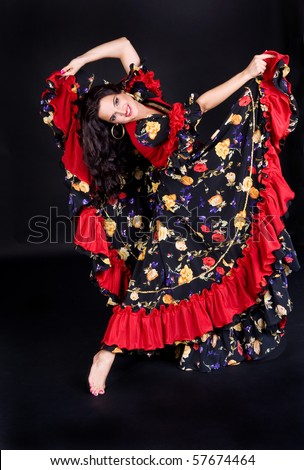 Dancing woman in beautiful dress isolated on black