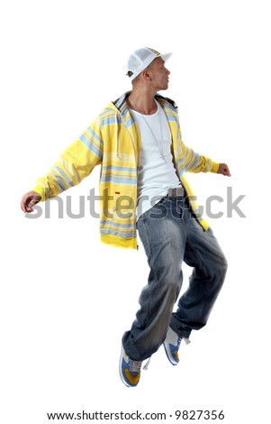 Dancing Young man with clothes in hip-hop style showing a dance move while jumping over pure white background. - stock photo