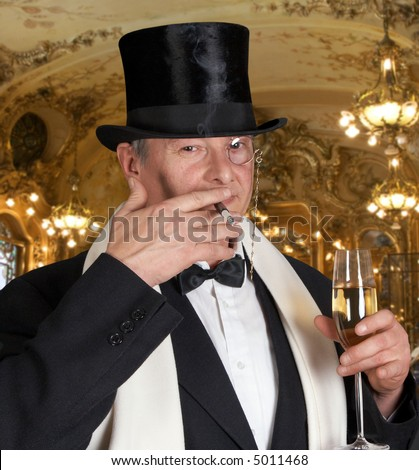Dandy figure with bow-tie, top hat and a monocle - stock photo