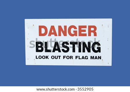 danger blasting sign isolated on blue