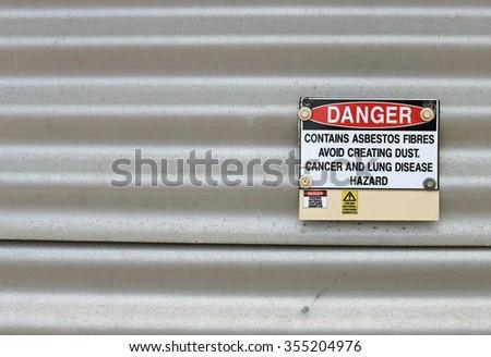 Danger, Contains Asbestos warning sign - stock photo