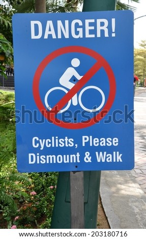 Danger cyclist please dismount and walk sign - stock photo