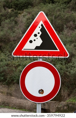Danger Falling Rocks on the Street Triangular Signal on the Top. Fired Circular White and Red Street Signal on the Bottom.  - stock photo
