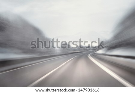 Danger fast artistic driving at the highway. Motion blur visualizies the speed and dynamics. - stock photo