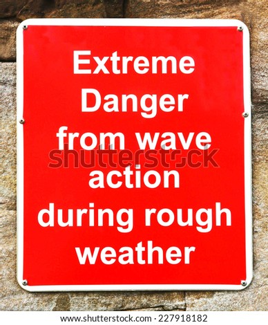Danger from wave action in rough weather warning sign - stock photo