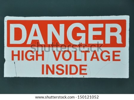 Danger high voltage inside signage - stock photo