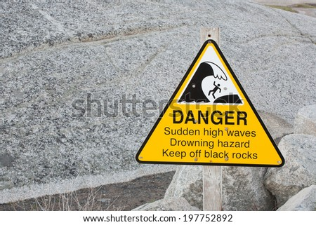 Danger - high waves hazard sign. - stock photo