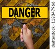 Danger in Magnifying glass ,industry background - stock photo