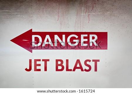 danger jet blast warning on the side of a jet fighter - stock photo