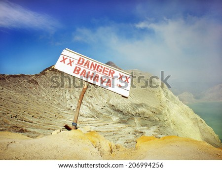 DANGER Label at Kawah Ijen volcano in East Java, Indonesia. sulfur mining industry