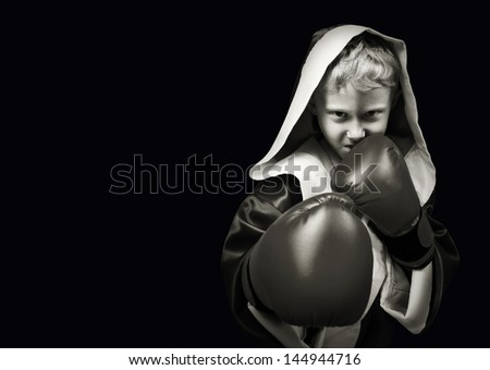 Danger looking young boxing fighter on black background - stock photo
