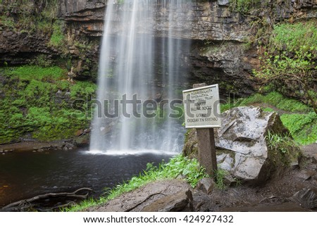 Danger sign at Henrhyd Falls Henrhyd Falls near Coelbren, the highest waterfall in South Wales, UK - stock photo