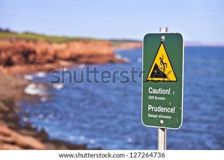 Danger sign on eroding cliffs of the National Park on the north shores of Prince Edward Island, Canada. - stock photo