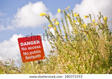 danger sign with prohibited access to a footpath - stock photo