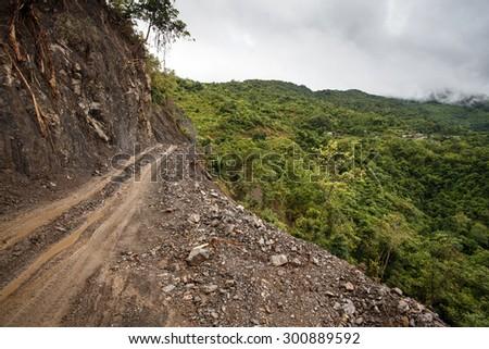 Dangerous Dirt Road Leading Through Chin State Mountainous Region, Myanmar (Burma) - stock photo
