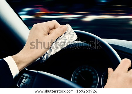 dangerous driving Caution! Driving under the influence of medications and/or alcohol can be dangerous. - stock photo