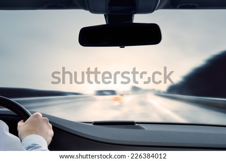 Dangerous Driving - Caution - poor view caused by spray water. - stock photo