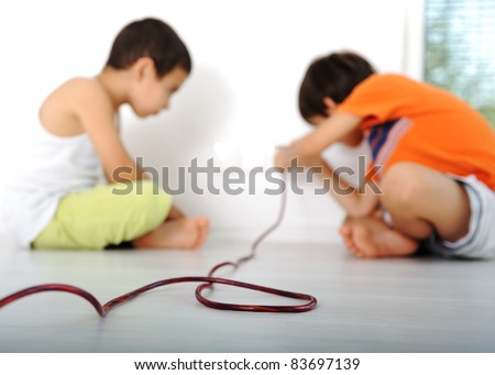 Dangerous game, children experimenting with electricity - stock photo