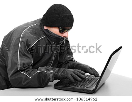 Dangerous hacker with laptop. Data security concept.