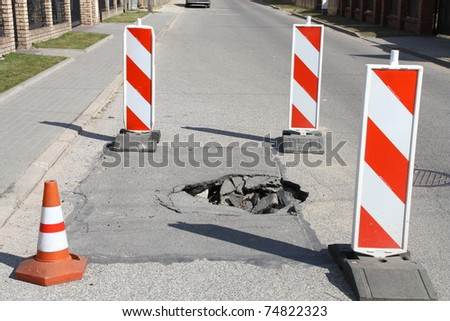 Dangerous hole in the road