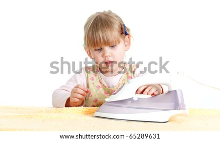 dangerous housework - little, blond hair girl ironing - stock photo