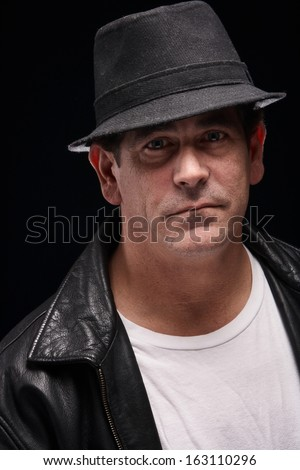Dangerous looking mobster criminal tough man  - stock photo