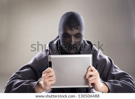 Dangerous man in mask with tablet on isolated background