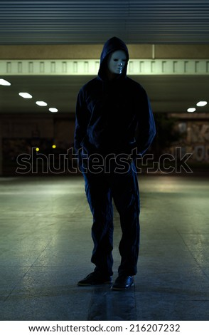 Dangerous man wearing mask in the city - stock photo