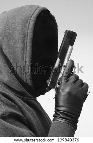 Dangerous Man with Gun - stock photo