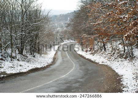 dangerous road in the woods at winter