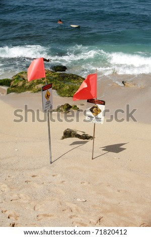 dangerous surf conditons signs on the beach in maui - stock photo