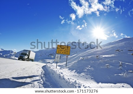 Dangerous Winter Road. Truck on the Loveland Pass Road in Colorado. Extreme Road for Truck Drivers. Lower Gear Requirement. Transportation Collection. - stock photo