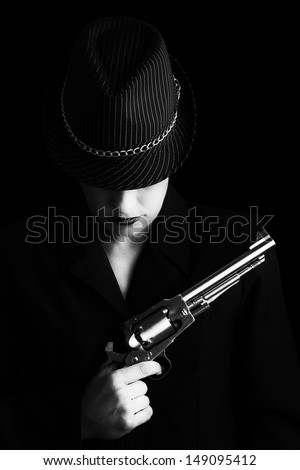 Dangerous woman in black with silver handgun and stylish hat artistic conversion - stock photo