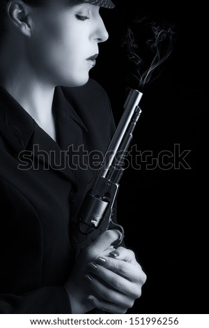 Dangerous woman in black with silver smoking handgun and stylish hat artistic conversion