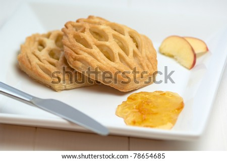 danish apple pastry, apple slice and gem on the plate - stock photo