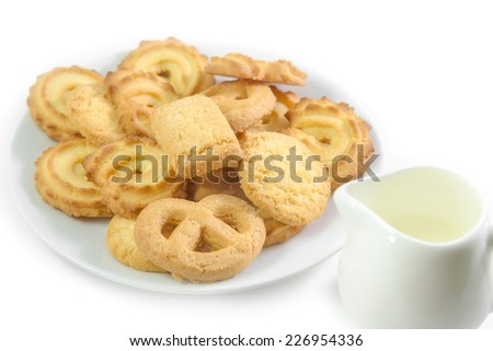 Danish Cookies with jug of milk isolated on white background - stock photo