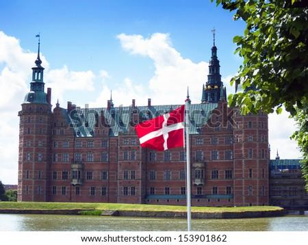 Danish Flag. Frederiksborg Palace, Copenhagen, Denmark - stock photo