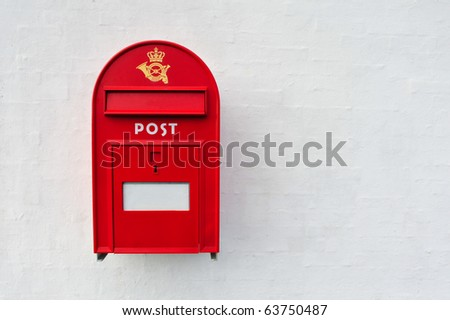 Danish red mailbox on white wall background
