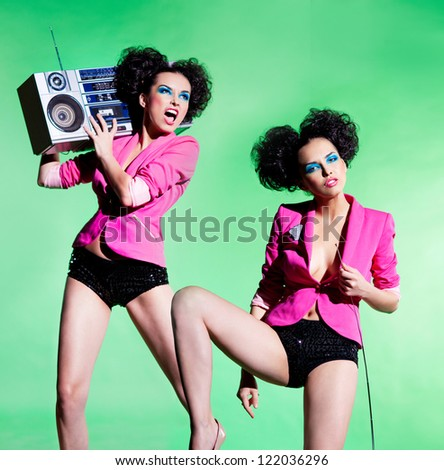Dansing girls with a tape recorder - stock photo
